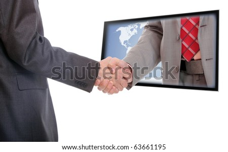 Businessmen shaking hands out of TV screen - stock photo