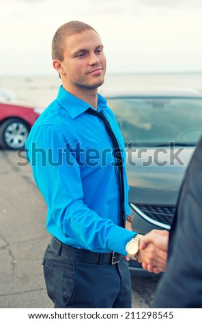 Businessmen shaking hands over a deal. - stock photo