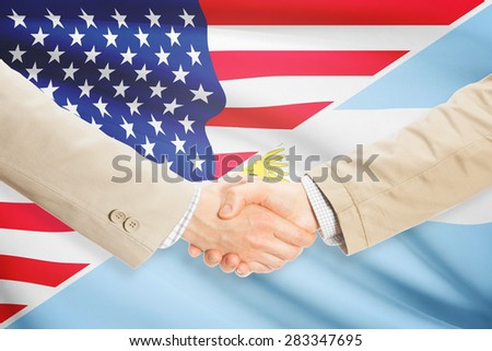 Businessmen shaking hands - United States and Argentina