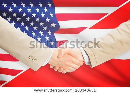 Businessmen shaking hands - United States and Austria
