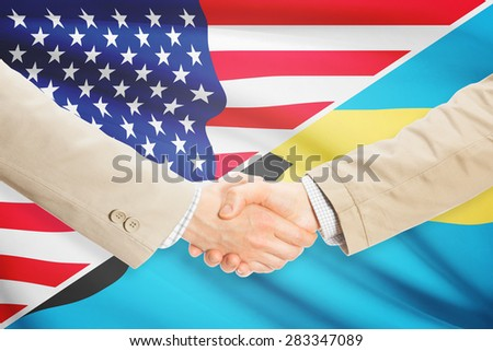 Businessmen shaking hands - United States and Bahamas