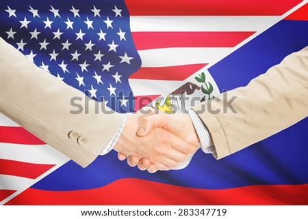 Businessmen shaking hands - United States and Belize