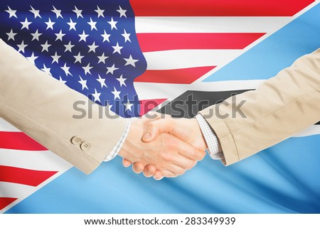 Businessmen shaking hands - United States and Botswana