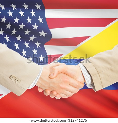 Businessmen shaking hands - United States and Colombia