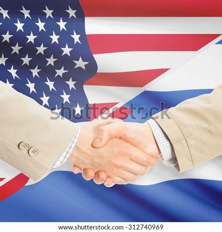 Businessmen shaking hands - United States and Cuba
