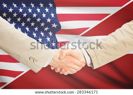Businessmen shaking hands - United States and Latvia