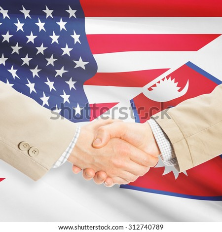 Businessmen shaking hands - United States and Nepal