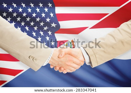 Businessmen shaking hands - United States and Paraguay