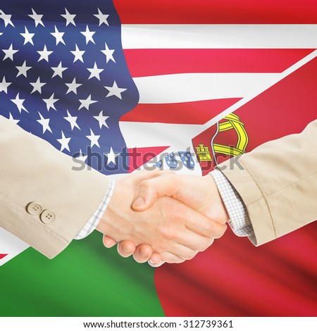 Businessmen shaking hands - United States and Portugal