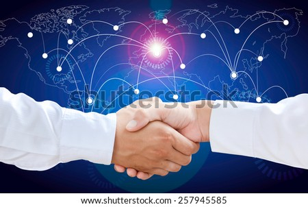 Businessmen Shaking Hands with a Global Communication Background - stock photo