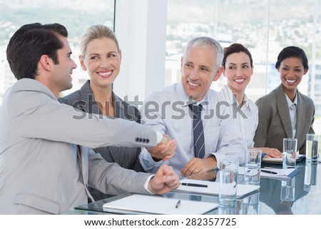 Businessmen shaking their hands during conference in the office - stock photo