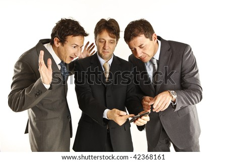 businessmen showing each other a telephone
