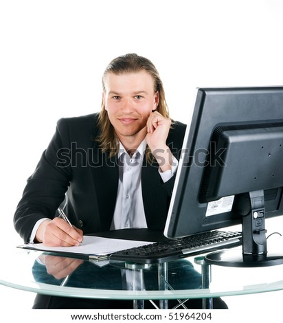 Businessmen sits at the computer. Studio shot - stock photo