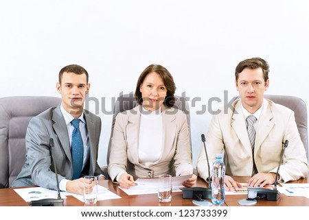 businessmen sitting in a chair at the table, communicate at the conference - stock photo