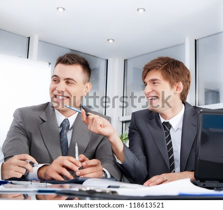 Businessmen smile talking laughing on meeting, Successful and happy businesspeople team sitting at desk in office, Group of business people communicate - stock photo