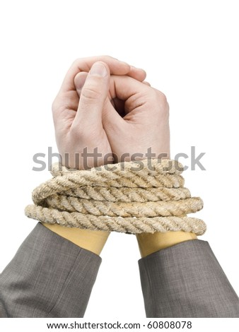 Businessmen tied hand - stock photo