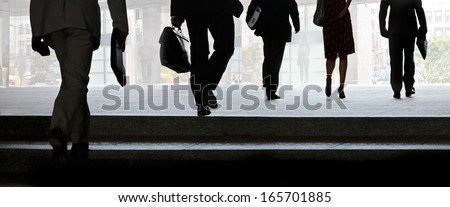 Businessmen walking on the street. Urban scene.