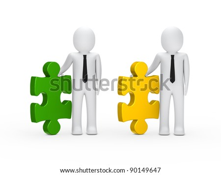 Businessmen with black tie hold a puzzle