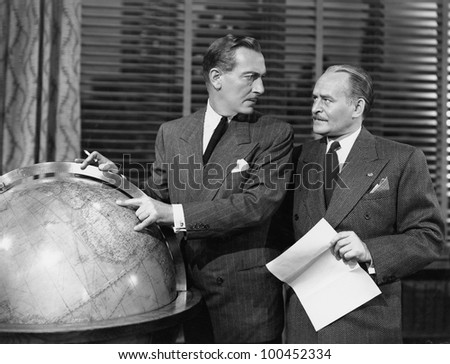 Businessmen with globe