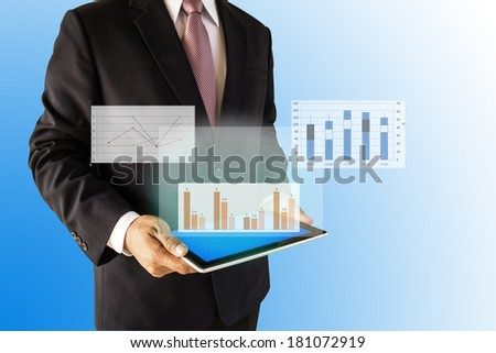 businessmen with graph on tablet - stock photo