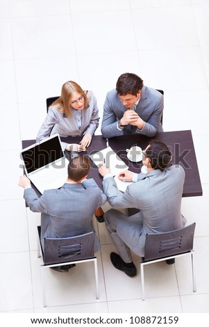 Businessmen with laptop in a meeting