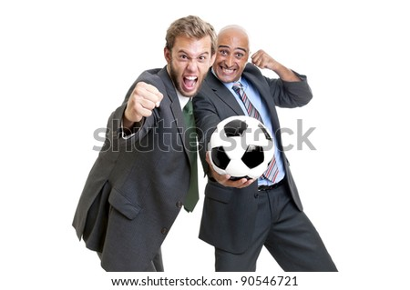 Businessmen with soccer ball posing - stock photo