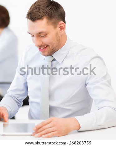 businessmen with tablet pc in office