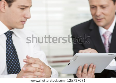 Businessmen working with digital tablet