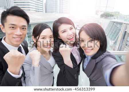 businesspeople are smile happily and selfie in hongkong, asian