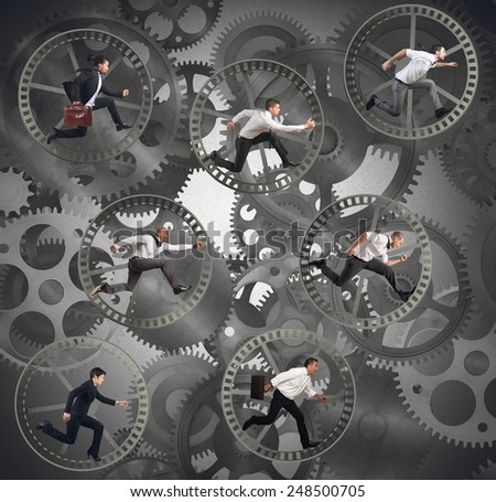 Businesspeople as gear parts of a machine - stock photo
