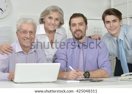 businesspeople at office with laptop - stock photo