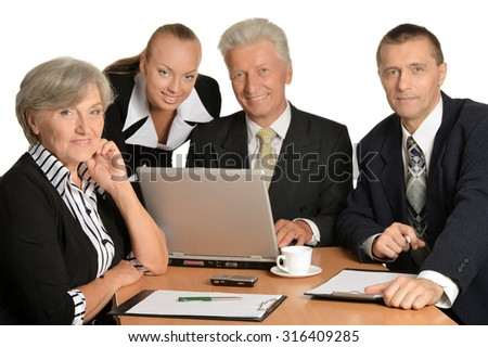Businesspeople at work with laptop on white background - stock photo