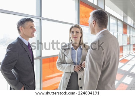 Businesspeople communicating on train platform