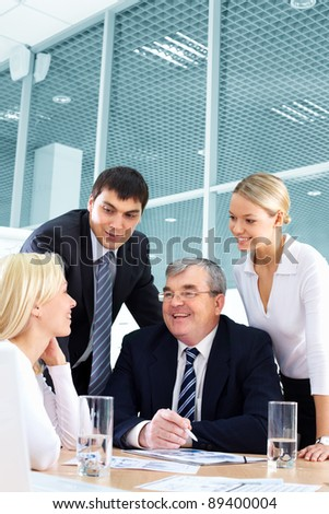 Businesspeople developing a successful business plan - stock photo