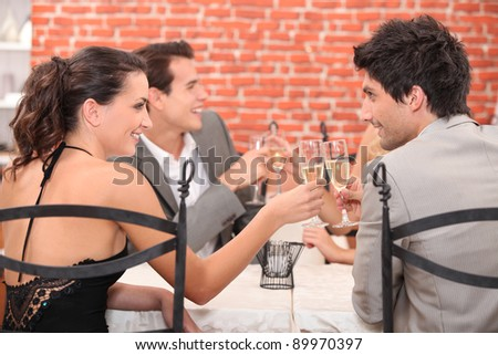 Businesspeople eating lunch in restaurant - stock photo