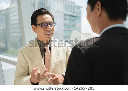 Businesspeople explaining pros and cons of the business idea - stock photo