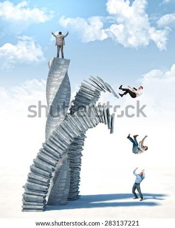 businesspeople fall from abstract stone tower - stock photo