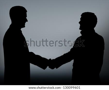 Businesspeople figures. Handshake. - stock photo