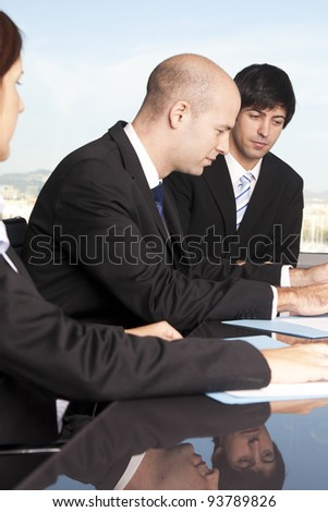 Businesspeople having a break during meeting - stock photo