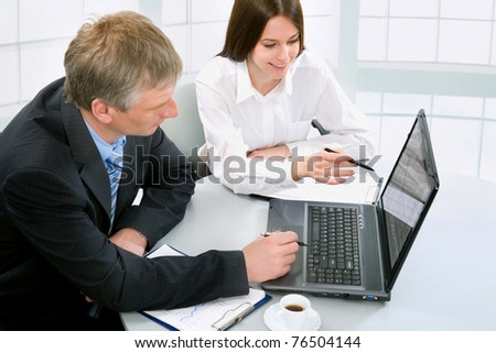 Businesspeople having a business meeting in office, using laptop computer. - stock photo