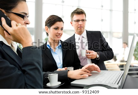 Businesspeople having discussion over the coffee table. - stock photo