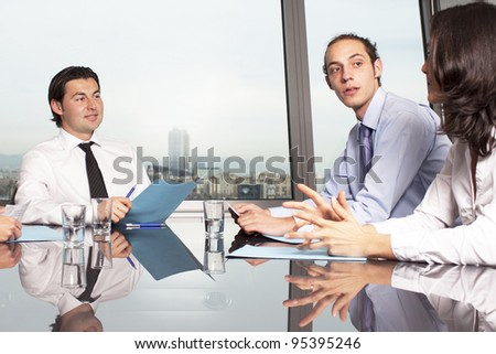 Businesspeople having fun and talking in the office