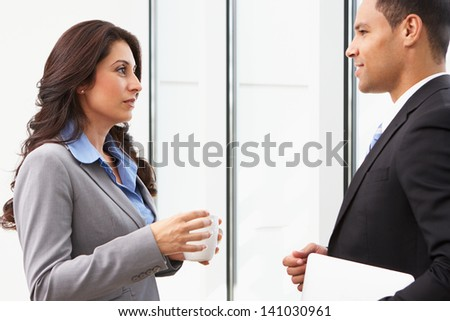 Businesspeople Having Informal Meeting In Office - stock photo