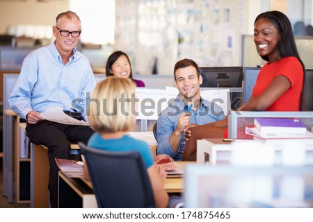 Businesspeople Having Meeting In Modern Open Plan Office - stock photo