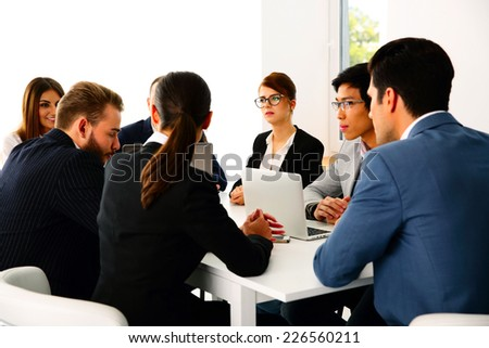 Businesspeople having meeting in the office - stock photo