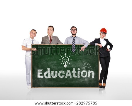 businesspeople holding blackboard with education concept - stock photo