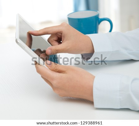 Businesspeople holding digital tablet, closeup. - stock photo