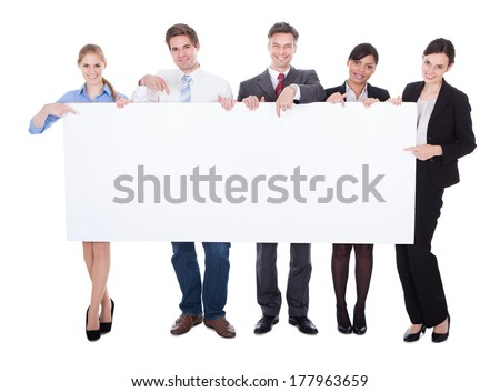 Businesspeople In A Group Holding A Blank Card Board Over White Background - stock photo