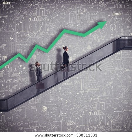 Businesspeople in an escalator with arrow growing - stock photo