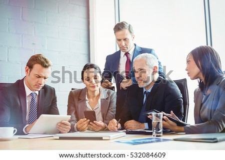 Businesspeople in conference room during meeting at office